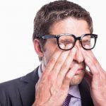 Eye doctor, man rubbing his eyes with eye allergy in Garden Grove, CA