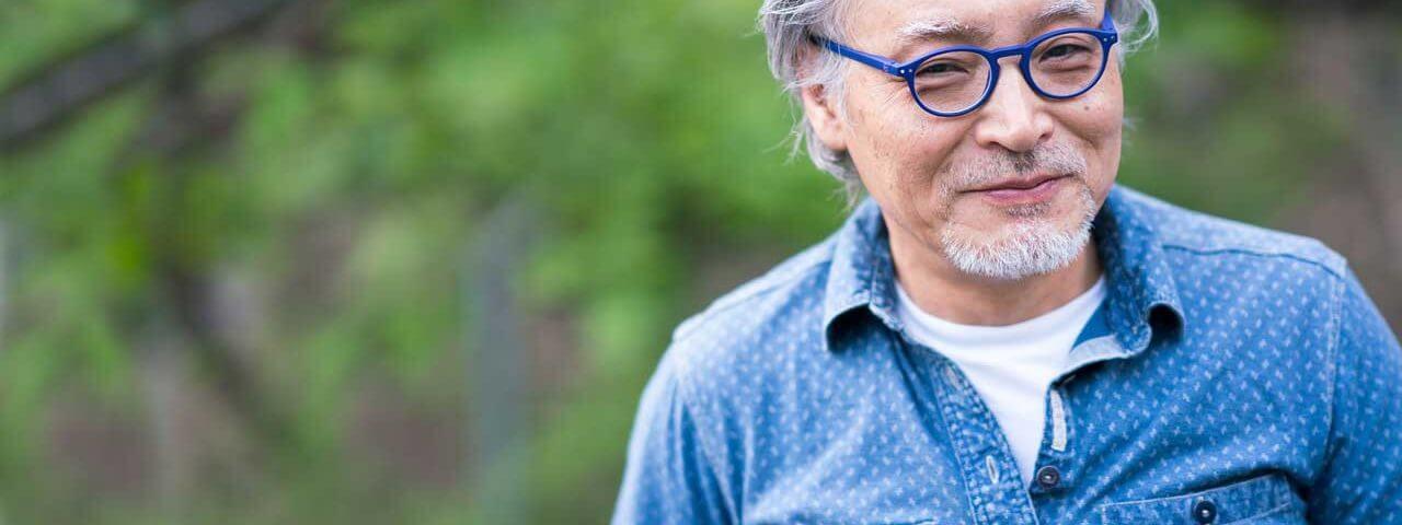 senior man with glasses having Presbyopia Diagnosis & Treatment In Garden Grove