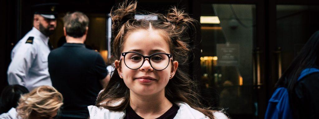 girl wearing glasses in Tesla City, Tesla State