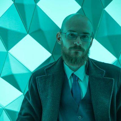 man blue background glasses 640
