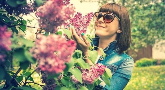 woman admiring flowers 640