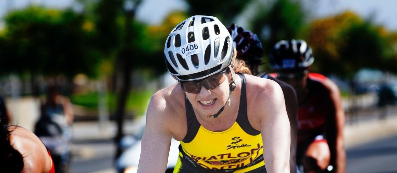 woman cycling wearing sports eyewear