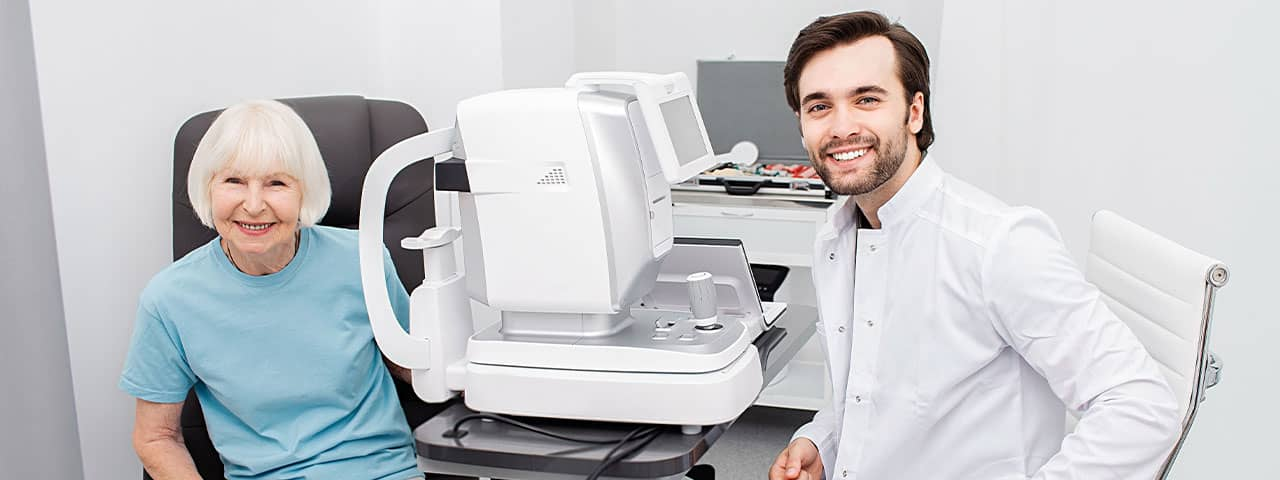 Smiling Optometrist low vision eye exam 1280×480