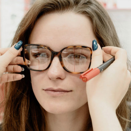 woman-trying-on-a-new-pair-of-glasses-640-427x427