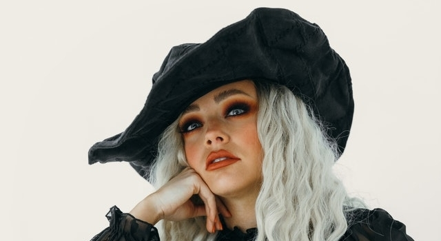 woman wearing a witch costume 640×350