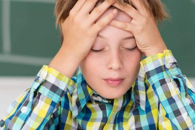 Young-Boy-Concentrating-1280x480-640x427