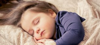 child sleeping with vision correcting contact lenses from Dr. Elliott Shapiro, Family Optometry Inc. Eye Exam near you San Diego, California