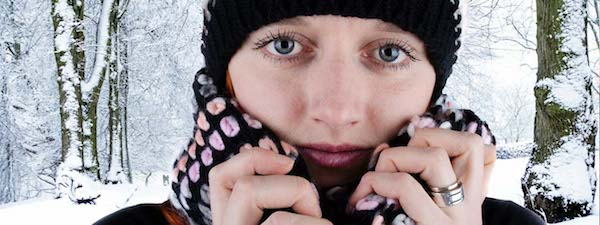Woman in winter clothing, suffering dry eye