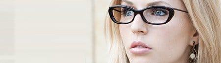 person looking serious designer eyewear frames