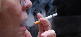 Person wearing glasses smoking cigarette, optometrist, eye exam, Orlando, FL