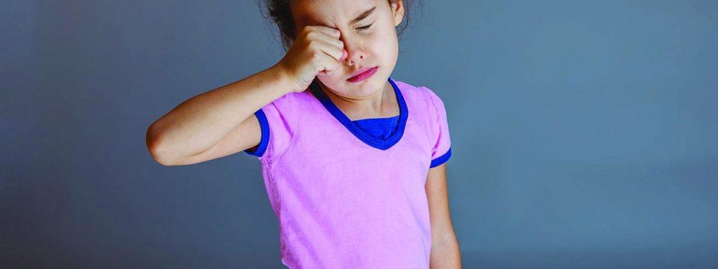 pink eye girl rubbing eye disease emergency