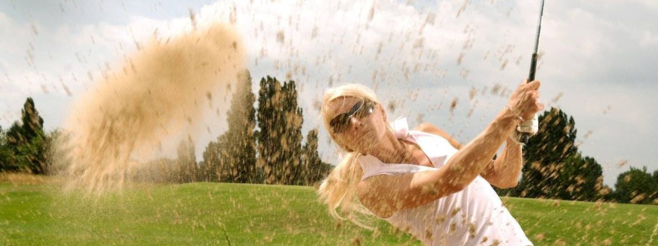 Eye doctor, woman playing golf with sport sunglasses in Lake Mary & Orlando, FL