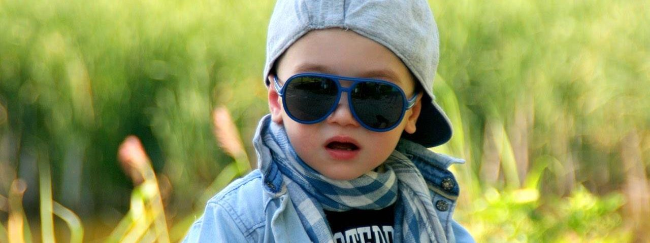 Eye doctor, boy wearing a sunglasses in Lake Mary & Orlando, FL