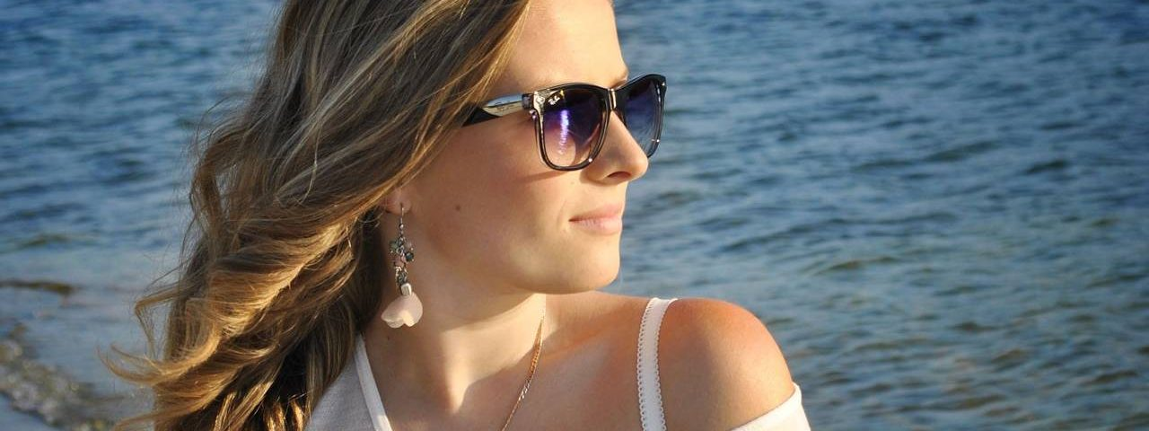 Eye doctor, woman wearing sunglasses in Lake Mary & Orlando, FL