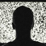 Person with Retinitis Pigmentosa watching TV