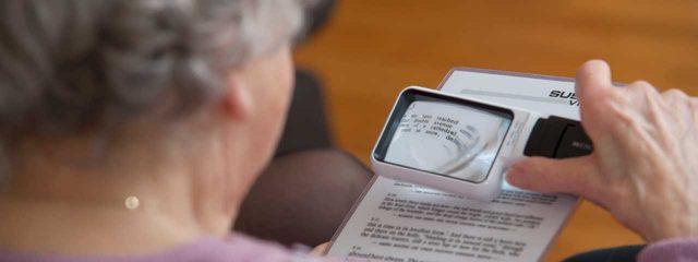 Woman using magnifier to read