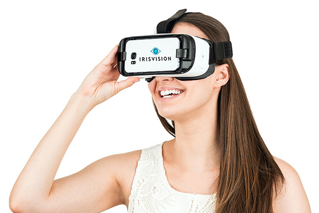 Woman using Iris Vision Low Vision Device