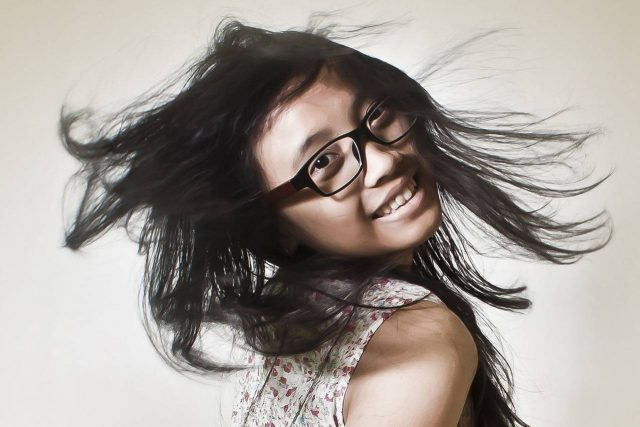 Happy Girl Flippig Hair Glasses 1280x853 640x427