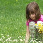 eye care, little girl collecting flowers in Belmont North Carolina