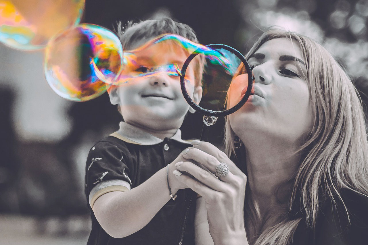 Mom Son Blowing Bubbles 1280x853