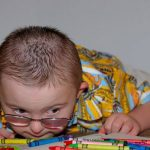 Eye Care, special needs boy with crayons Palmetto Bay, FL