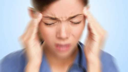 woman with vertigo and headache