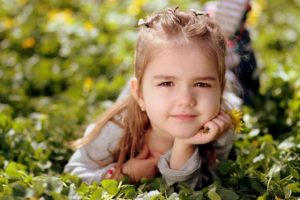 little girl squinting outside. Vision therapy near you at New Baltimore Optometry