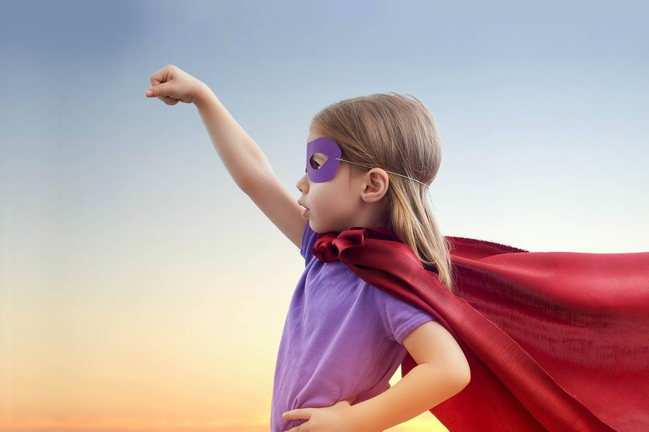little girl dressed as a super hero