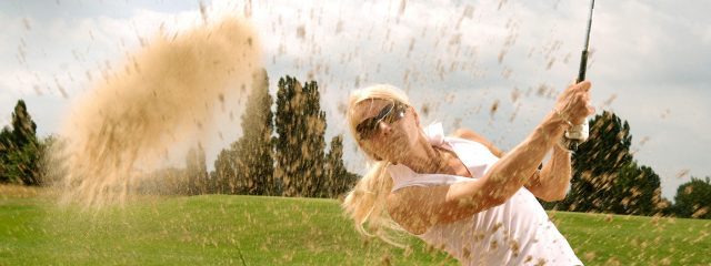 Eye doctor, woman playing golf in New Baltimore, Michigan