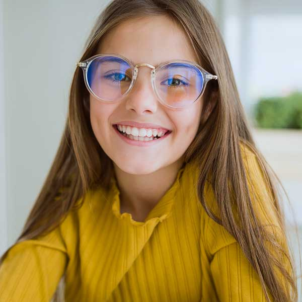 girl smiling vision therapy sq blue 2