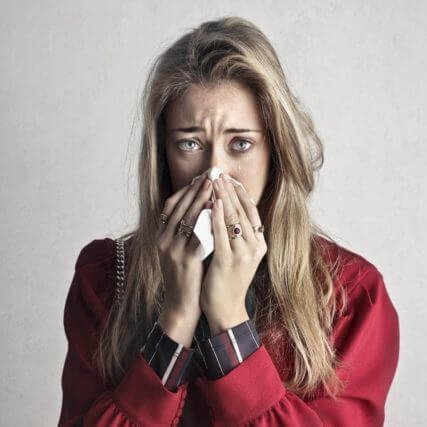young woman suffering from eye allergies