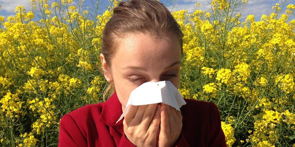Girl blowing nose in field, eye allergy, optometrist, Katy, TX