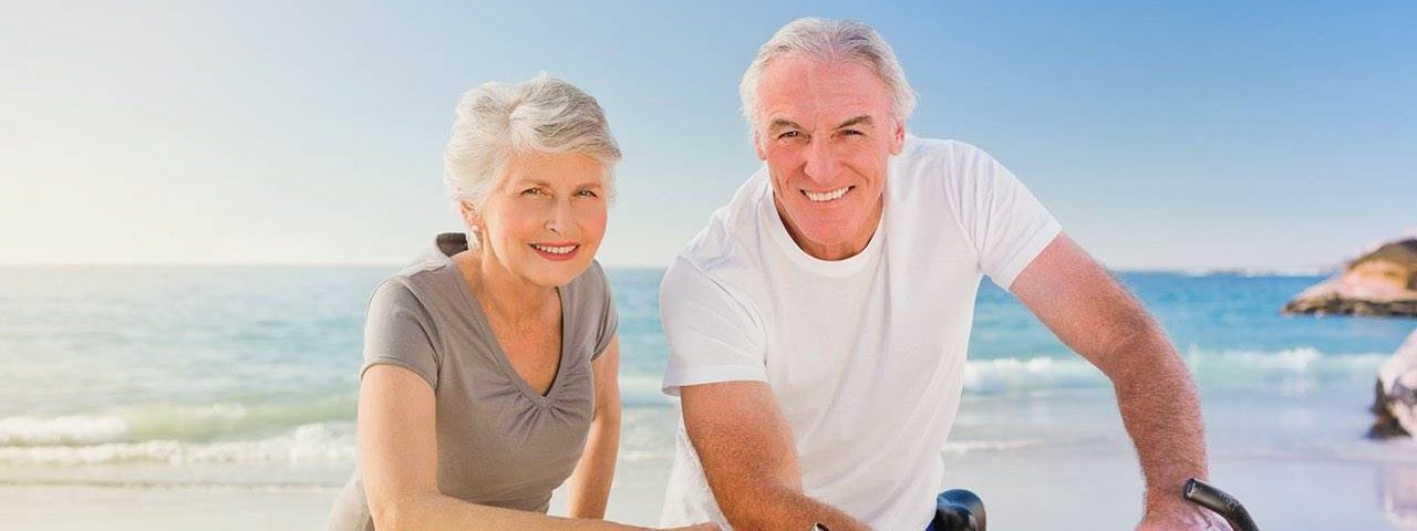 Senior couple at the beach on bicycles in Katy, TX