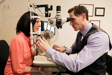 Dr. Boaz using eye care technology during eye exam