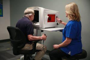 Optometrist, senior man using AdaptDx in The Woodlands, TX