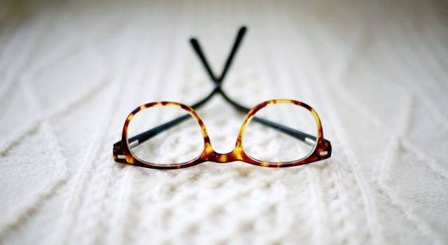 glasses on white sweater 640x350.jpg