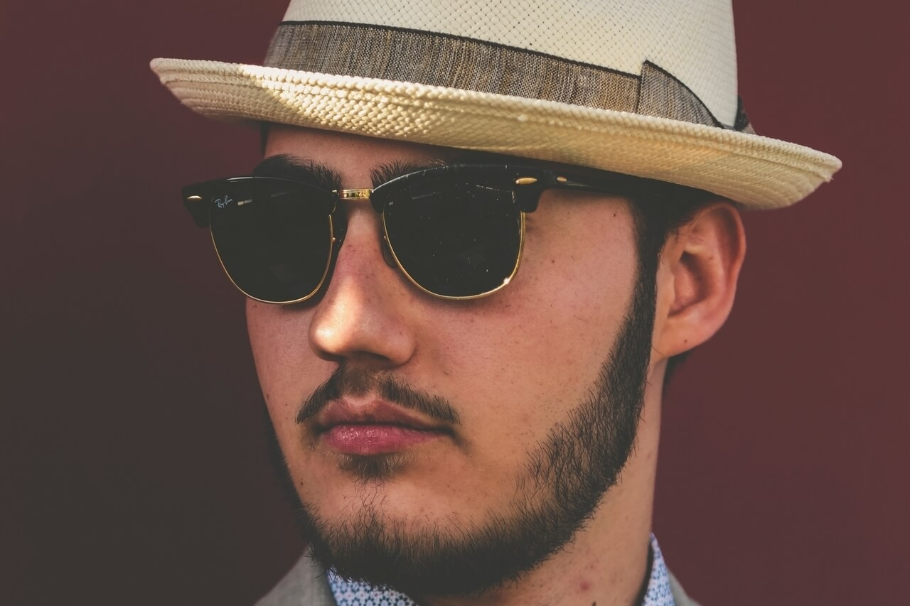 young man hat sunglasses 1280x853