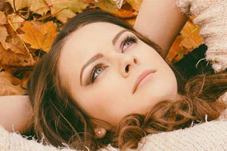 dry eye lady laying in leaves.jpg