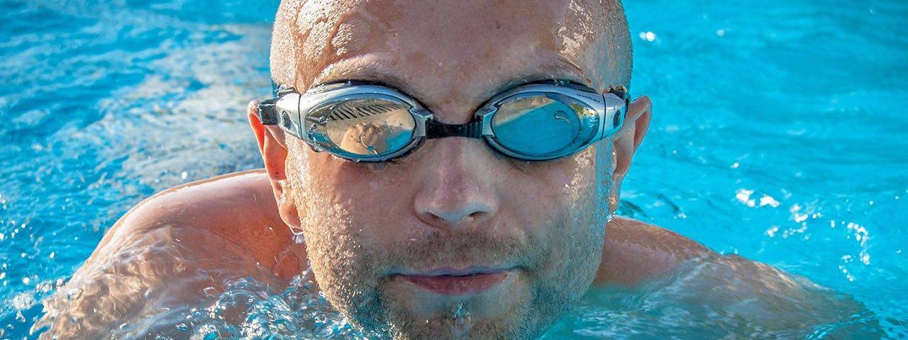 Man swimming and wearing goggles, Eye Doctor in Fort Worth, Texas