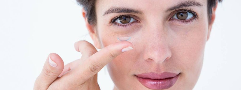 Woman holding contact lens, Eye Doctor in Fort Worth, TX