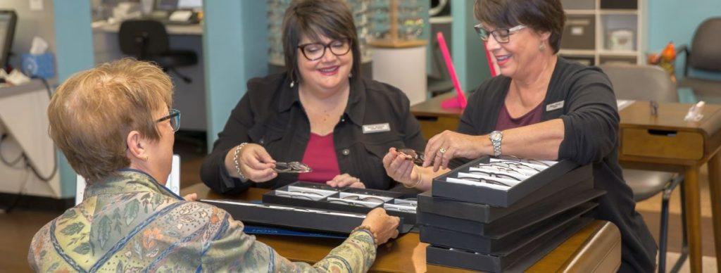 Kristin L. Campbell, OD assisting patient with eyeglasses in Eyeglasses Boutique, Eye Care, Delaware & Ostrander, OH