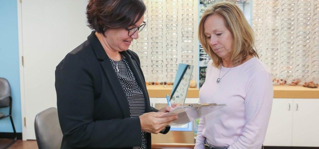 Optometrist with patient - Eye Care, Ostrander &  Delaware, OH