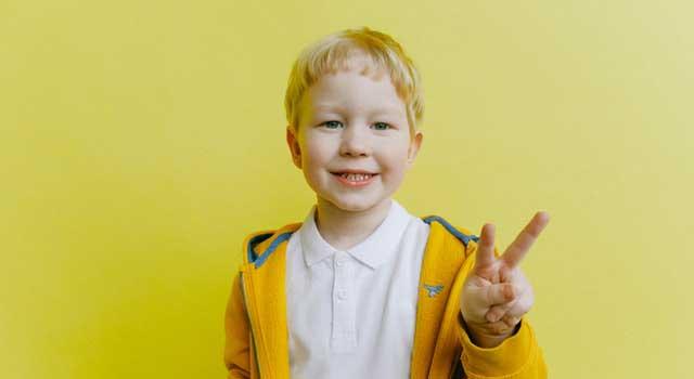 boy in yellow zip up jacket 3771646