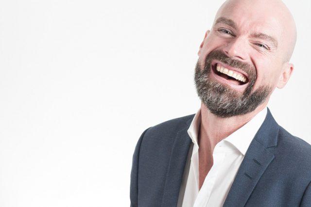 Eye doctor, happy man wearing bifocal contact lenses in Raleigh, NC