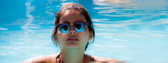 Woman wearing specialty eyewear in pool