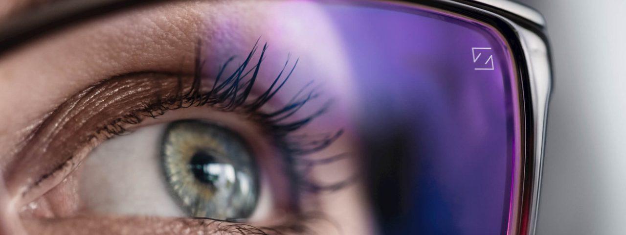 Eye of person wearing Zeiss eyeglass lenses