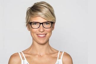 happy woman wearing salt eyewear