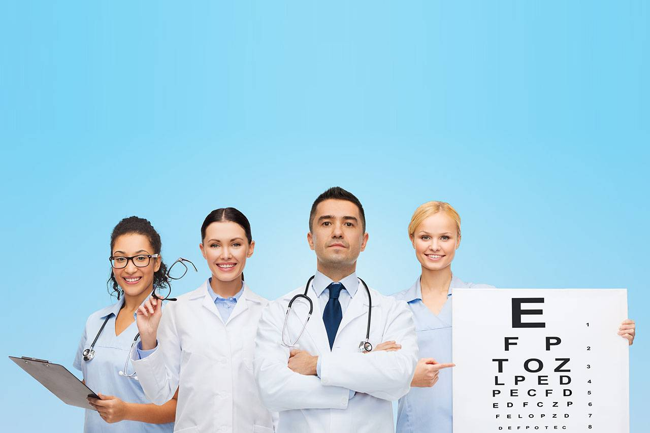 group of eye doctors with eye charts and glasses in Laguna Beach, California