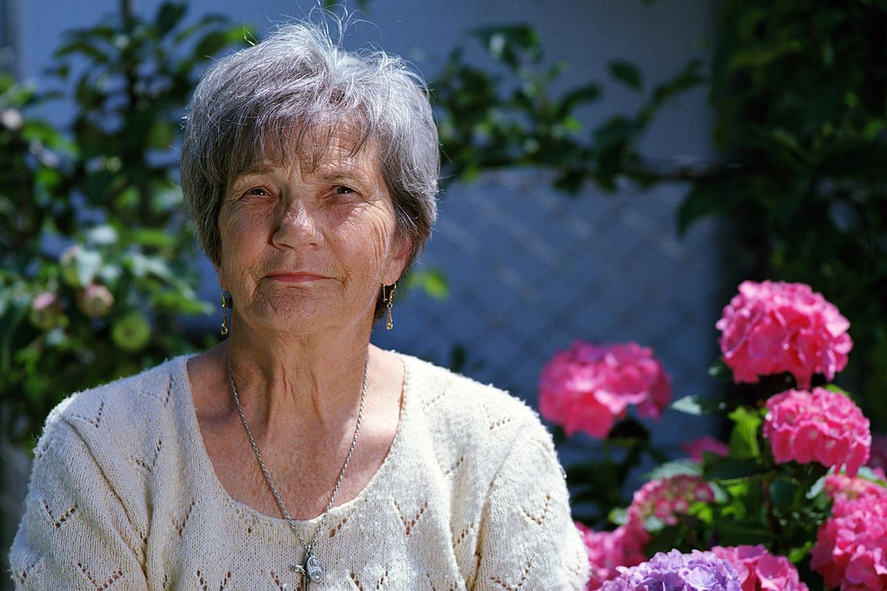 Elderly Woman Pink Flowers 1280x853
