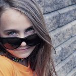 Girl wearing sunglasses after orthokeratology